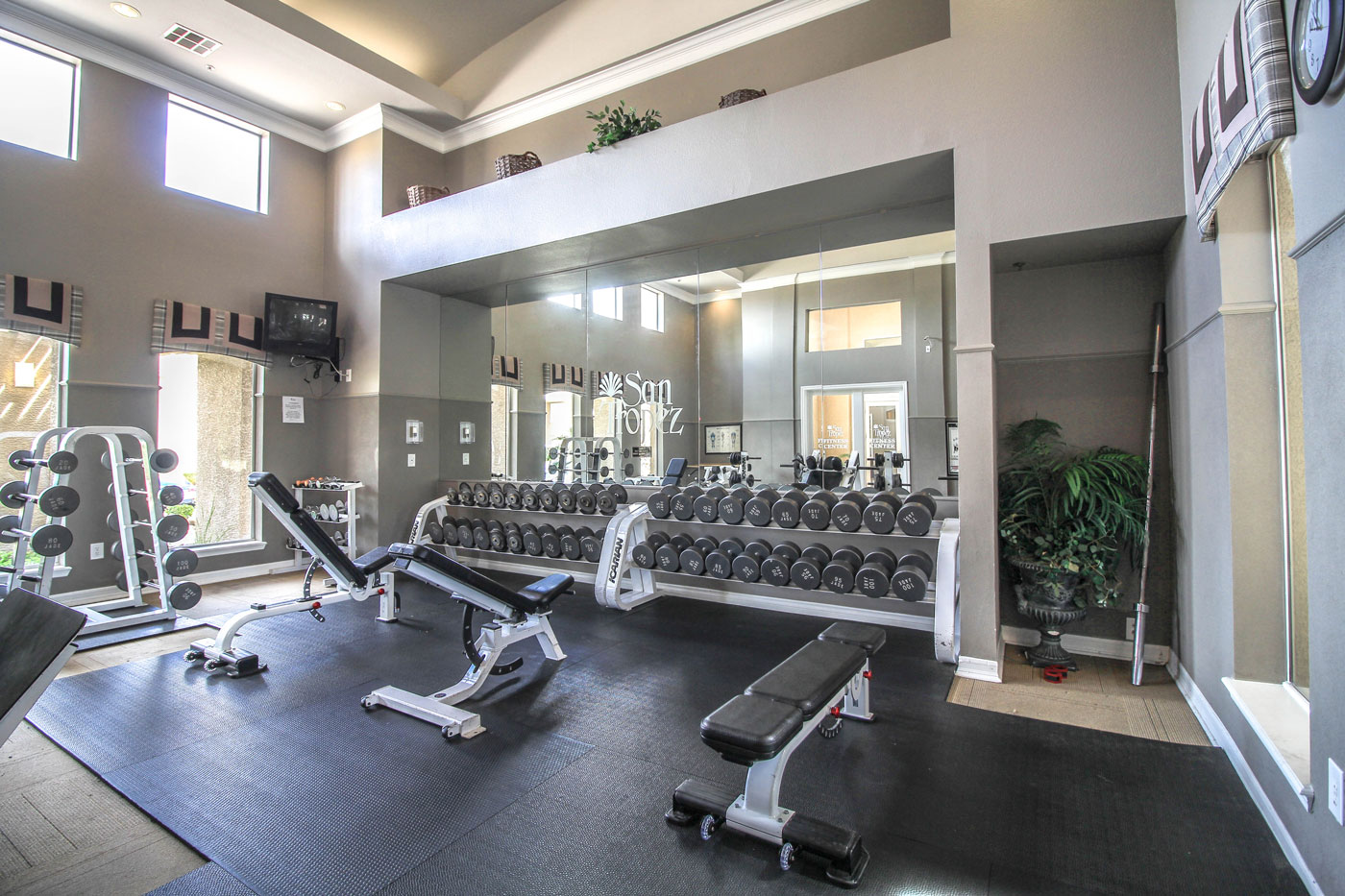 Weightroom with weight benches at San Tropez in Las Vegas.