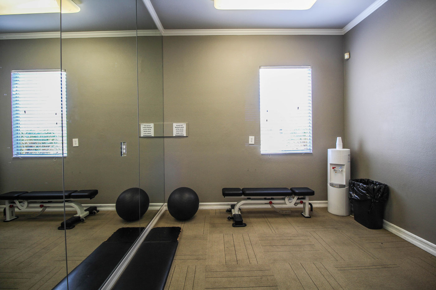Yoga room with water dispenser and medicine ball.