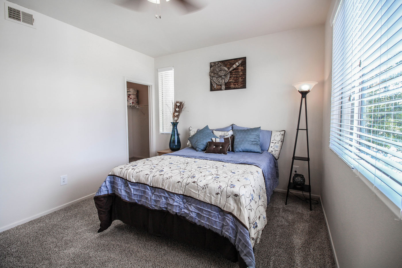 Bedroom with queen bed and blue decor.